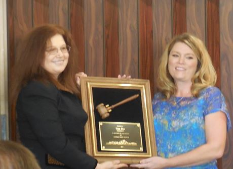 Elizabeth Szwabowski presenting the 2014 Past President award to Tina Dye.