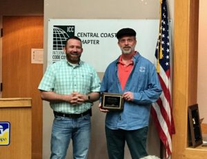 Todd Hansen receiving an award for RRM for their Community Service to the chapter.
